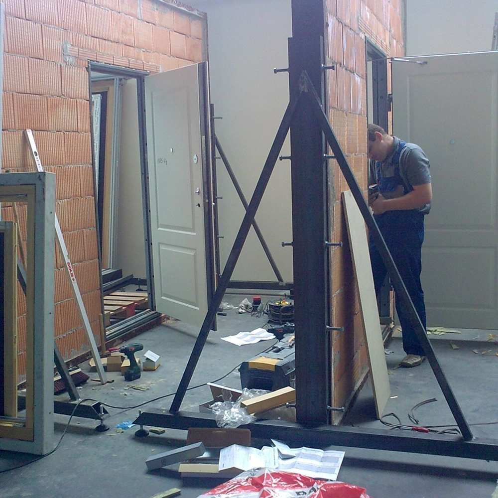 01_Doors being installed in replica real walls for the durability test